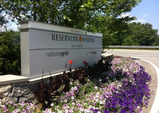 consistent graphics unify the Reservoir Woods campuses.