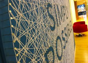 LogMeIn entrance branding, string wall, boston